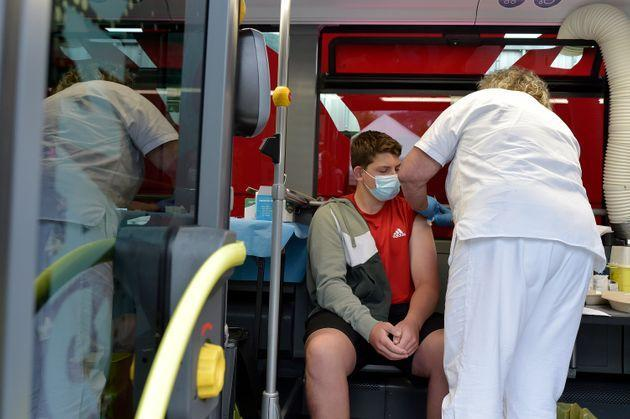 BOLZANO, ITALY - JULY 14: People receive their Covid-19 vaccine in one of two SASA buses equipped as vaccination centers, operating in the small towns of South Tyrol, on July 14, 2021 in Bolzano, Italy. Italy has administered some 58,213,710 doses of Covid vaccines to the population, accounting for 48.3% of the country's population. Covid-19 infections are increasing in Italy, with 1,195 new infections reported on average each day.  (Photo by Alessio Coser/Getty Images) (Photo: Alessio Coser via Getty Images)