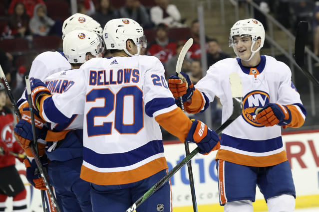 New York Islanders right wing Leo Komarov, center left, celebrates after scoring a goal with his teammates during the first period of a preseason NHL hockey game against the New Jersey Devils, Saturday, Sept. 21, 2019, in Newark, N.J. (AP Photo/Mary Altaffer)