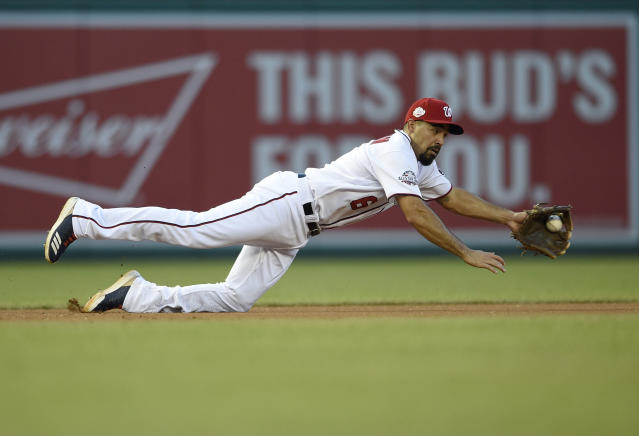 Washington Nationals third baseman Anthony Rendon dives for and stops a grounder by Miami Marlins' Cameron Maybin during the first inning of a baseball game Thursday, July 5, 2018, in Washington. Martin Prado was forced out at second for the third out. (AP Photo/Nick Wass)