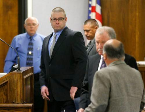 Former Marine Cpl. Eddie Ray Routh, center, appears in court on the opening day of his capital murder trial at the Erath County Donald R. Jones Justice Center, Wednesday, Feb. 11, 2015, in Stephenville, Texas. Routh, 27, of Lancaster, Texas, is charged with the 2013 deaths of former Navy SEAL Chris Kyle and his friend Chad Littlefield at a shooting range near Glen Rose, Texas. (AP Photo/The Dallas Morning News, Tom Fox, Pool)