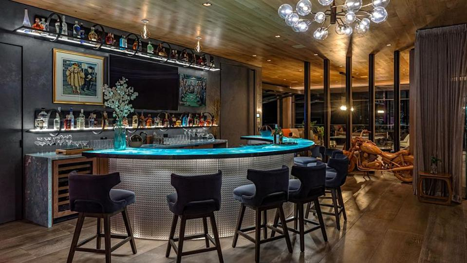 The alluring bar within the home, accented with shelf and bar top lighting. - Credit: Simon Berlyn