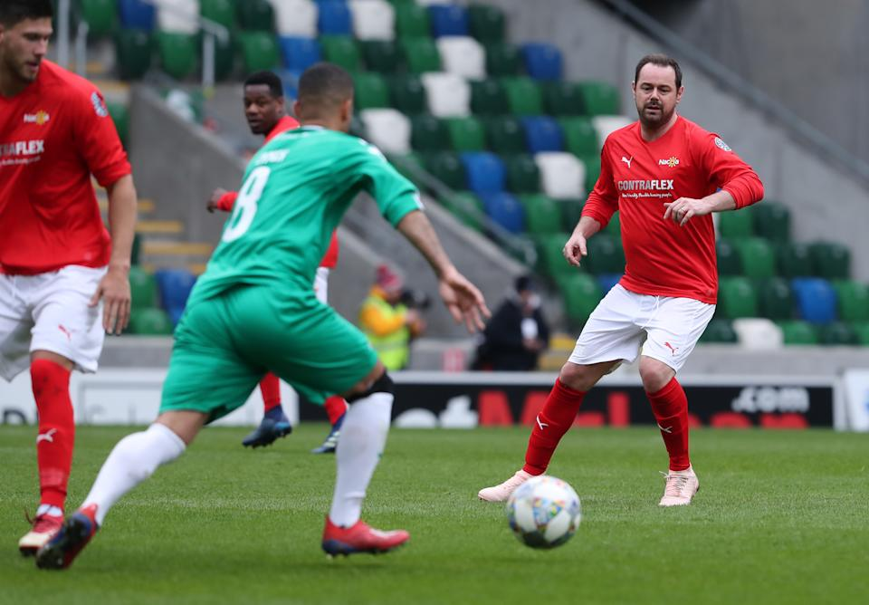 Danny Dyer has always been a keen player and fan of football, appearing in numerous celebrity matches. (Niall Carson/PA Images/Getty)