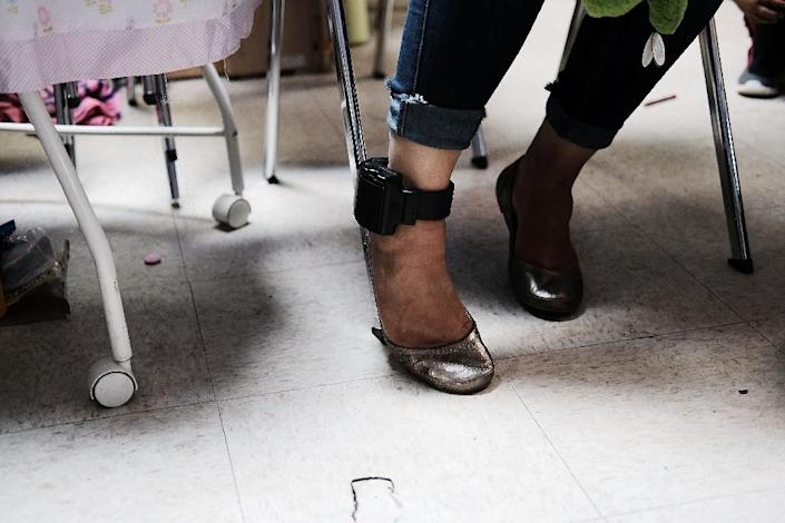 Immigrants released from custody must wear electronic ankle bracelets, sold to US authorities by BI Incorporated, to monitor their location (AFP Photo/SPENCER PLATT)