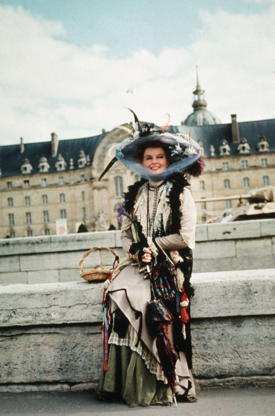 <p>Talk about Paris fashion. The always-stylish Katharine Hepburn takes a break on set of <em>The Madwoman of Chaillot </em>in her iconic costume.</p>
