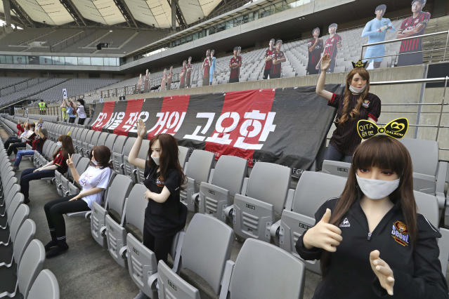 "In this May 17, 2020, photo, cheering mannequins are installed at the empty spectators' seats before the start of a soccer match between FC Seoul and Gwangju FC at the Seoul World Cup Stadium in Seoul, South Korea. A South Korean professional soccer club has apologized after being accused of putting sex dolls in empty stands during a match Sunday in Seoul. In a statement, FC Seoul expressed ""sincere remorse"" over the controversy, but insisted that it used mannequins, not sex dolls, to mimic a home crowd during its 1-0 win over Gwangju FC at the Seoul World Cup stadium. (Ryu Young-suk/Yonhap via AP)"