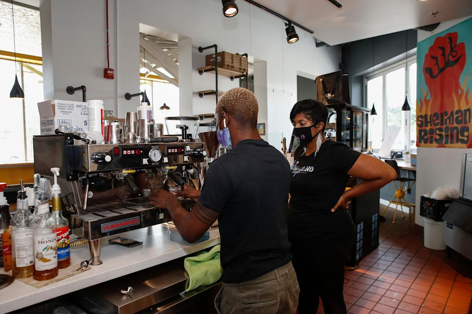 Baboonie Tatum, owner of the Rise & Grind Cafe, checks on an employee inside her coffee shop in Milwaukee on Aug. 15, 2020. (Photo: KAMIL KRZACZYNSKI via Getty Images)