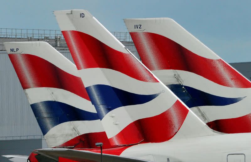 FILE PHOTO: British Airways logos are seen on tailfins at Heathrow Airport in west London