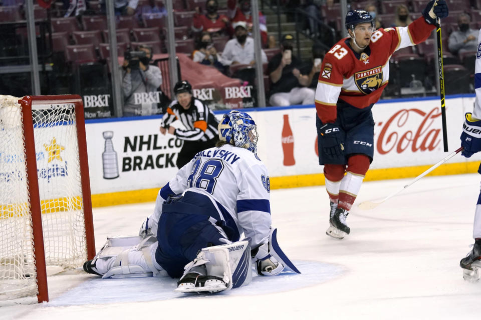 FILE - Florida Panthers right wing Juho Lammikko (83) reacts after scoring a goal against Tampa Bay Lightning goaltender Andrei Vasilevskiy (88) during the second period of an NHL hockey game in Sunrise, Fla., in this Monday, May 10, 2021, file photo. The butterfly style of goalies going down on their knees to stop the puck has completely taken over hockey, and specialized coaching and video helped them fix perceived weaknesses better than ever before. (AP Photo/Lynne Sladky, File)