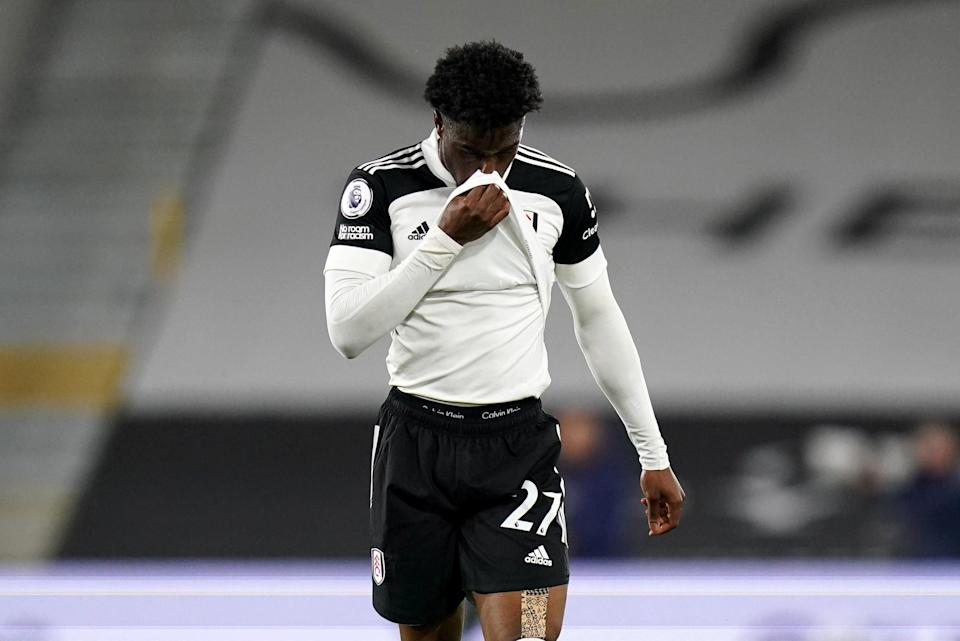 Down and out: Josh Maja cannot hide his emotions as he comes off last night following Fulham's relegationPA