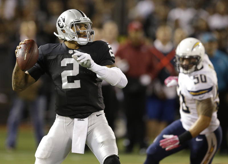 Oakland Raiders quarterback Terrelle Pryor (2) passes as San Diego Chargers inside linebacker Manti Te'o (50) applies pressure during the first quarter of an NFL football game in Oakland, Calif., Sunday, Oct. 6, 2013. (AP Photo/Ben Margot)