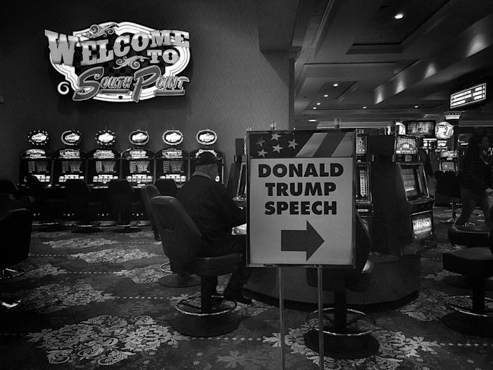<p>A sign pointing to a Donald Trump rally is seen next to the slot machines inside the South Point Casino on Feb. 22 in Las Vegas. (Photo: Holly Bailey/Yahoo News) </p>