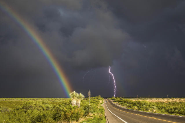 <p>A rainbow and lightning during a storm southeast of St. David, Ariz., on July 28, 2017. (Photo: Mike Olbinski/Caters News) </p>
