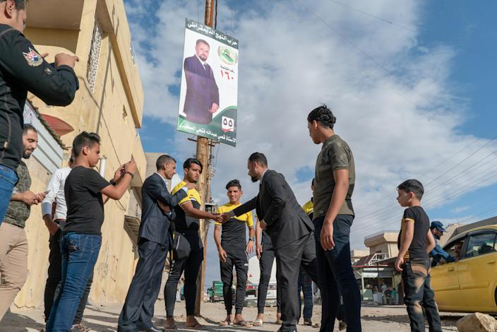 """""""We have great athletes here in our neighborhood, but they don't get any resources,"""" says Abdullah, meeting a group of young men in Mosul. (Photo: Shawn Carrié for Yahoo News)"""