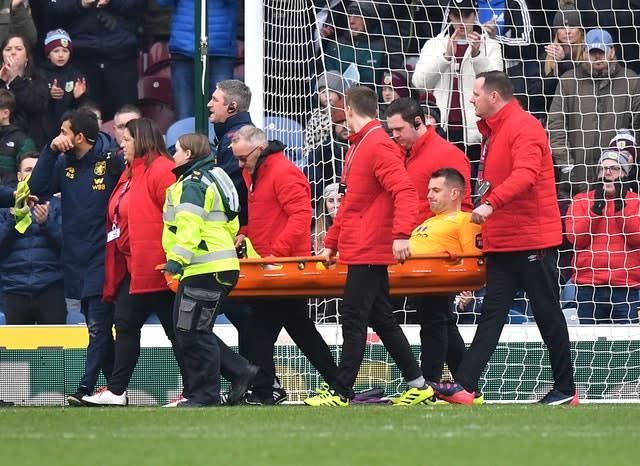 Tom Heaton was carried off on a stretcher (Anthony Devlin/PA)