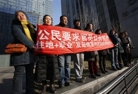 Supporters of Xu Zhiyong, one of China's most prominent rights advocates, shout slogans near a court where Xu's trial is being held, in Beijing January 22, 2014. REUTERS/Kim Kyung-Hoon
