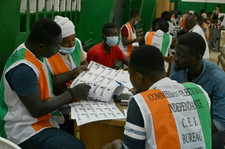 Electoral commission officials check the voters' roll on Saturday