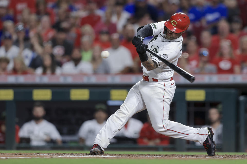 Cincinnati Reds' Tucker Barnhart hits an RBI single during the fifth inning of the team's baseball game against the Los Angeles Dodgers in Cincinnati, Friday, Sept. 17, 2021. (AP Photo/Aaron Doster)