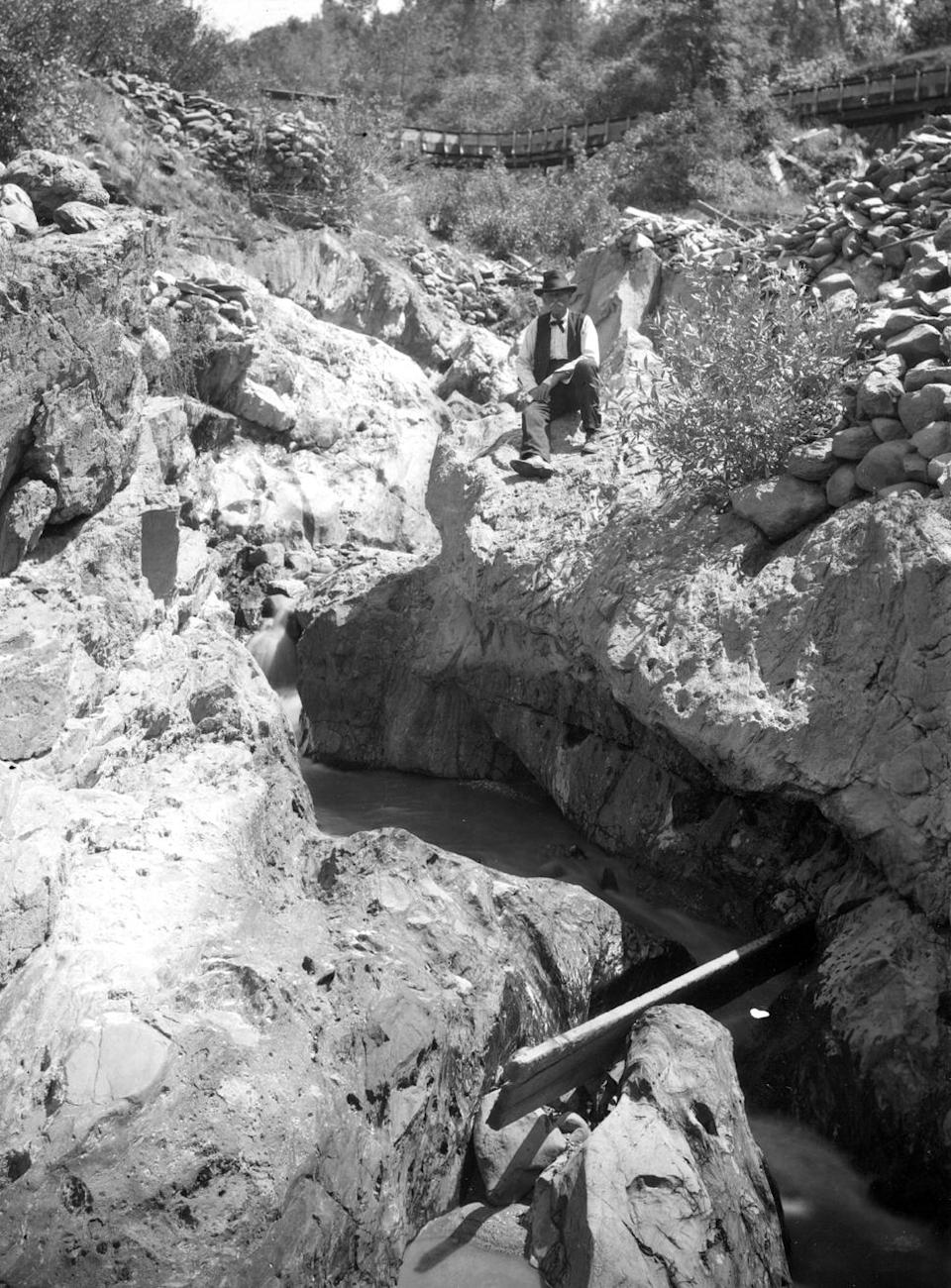 In this 1905 photo provided by the U.S. Geological Survey is a channel in bedrock worn by tailings of the Cherokee hydraulic mine in Butte County, Calif. Across the West, early miners digging for gold, silver and copper had no idea that one day something even more valuable would be hidden in the piles of dirt and rocks they tossed aside. Now there's a rush in the U.S. to find key components of cellphones, televisions, weapons systems, wind turbines, MRI machines and the regenerative brakes in hybrid cars, a group of versatile minerals on the periodic table called rare earth elements and old mining tailings piles just might be the answer. (AP Photo/U.S. Geological Survey)