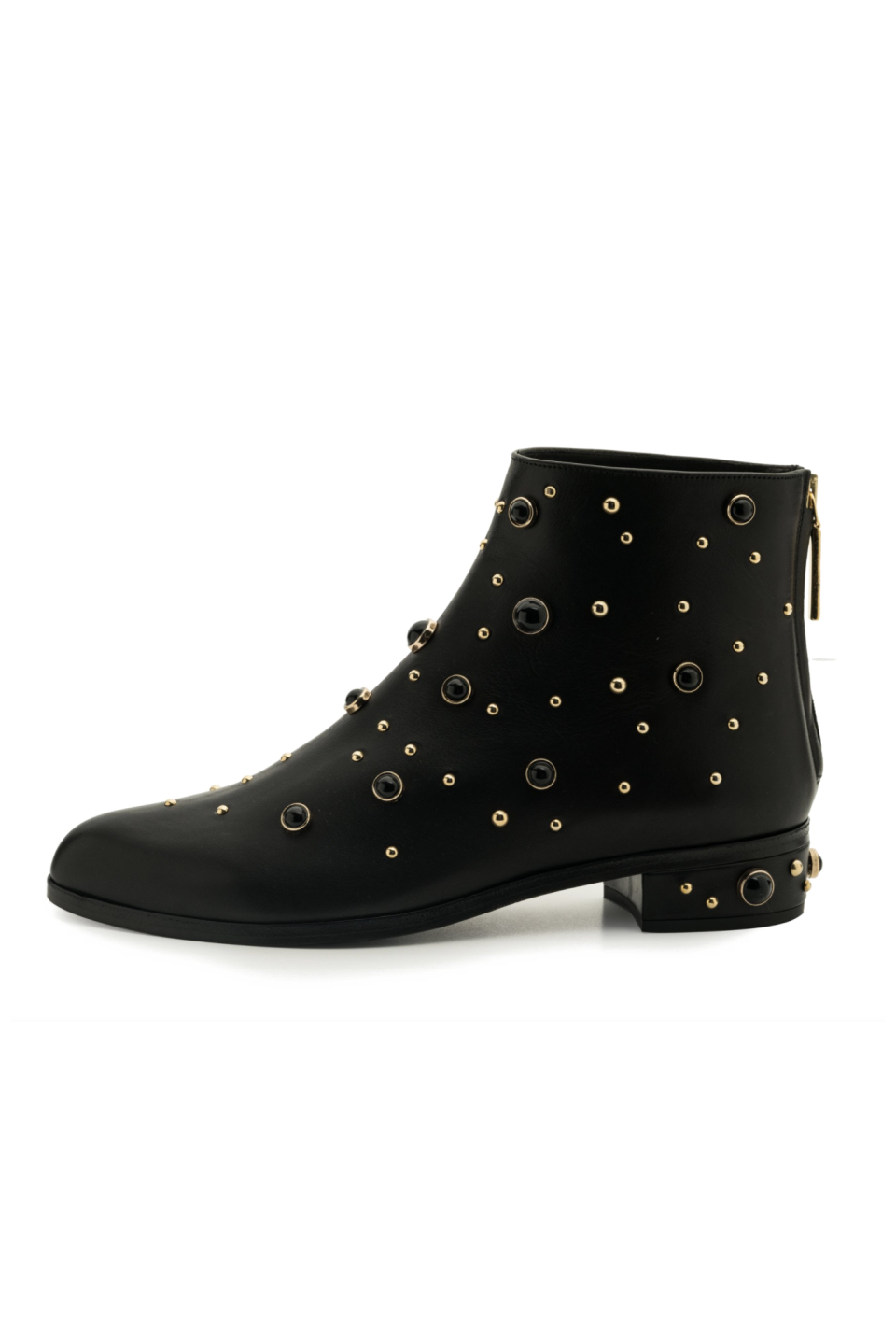 """<p><strong>Kendall Miles </strong></p><p>kendallmilesdesigns.com</p><p><strong>$568.75</strong></p><p><a href=""""https://www.kendallmilesdesigns.com/collections/womens-boots-booties/products/magnetic-calf-boot"""" rel=""""nofollow noopener"""" target=""""_blank"""" data-ylk=""""slk:SHOP IT"""" class=""""link rapid-noclick-resp"""">SHOP IT</a></p><p>These ankle boots feature everything, from glass studs to gold-rimmed embellishments, if you're looking for a shoe that has some extra personality. They're made in Italy and have a double padded leather insole for a comfortable, cushioned feel. </p>"""