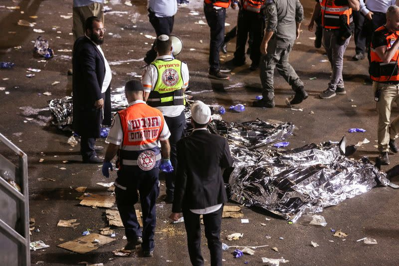 FILE PHOTO: Medics and rescue workers attend to the Lag B'Omer event in Mount Meron, northern Israel, where fatalities were reported among the thousands of ultra-Orthodox Jews gathered