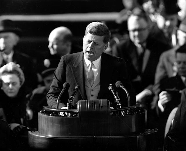 """U.S. President John F. Kennedy delivers his inaugural address after taking the oath of office at Capitol Hill in Washington, D.C. on Jan. 20, 1961. Kennedy said, """"We shall pay any price, bear any burden, meet any hardship, support any friend, oppose any foe, to assure the survival and success of liberty."""" Kennedy was sworn in as the 35th president of the United States. (AP Photo)"""