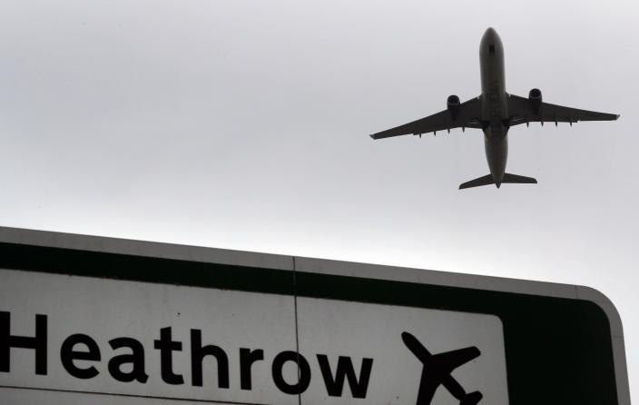 FILE - In this file photo dated Tuesday, June 5, 2018, a plane takes off over a road sign near Heathrow Airport in London. Travelers are packing their bags, café-owners are polishing their cutlery and stage performers are warming up as Britain prepared for a major step out of lockdown. But excitement at the reopening of travel and hospitality vied with anxiety about a more contagious variant spreading in the country. (AP Photo/Kirsty Wigglesworth, file)