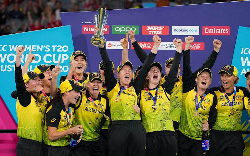 The Australian team celebrates with the trophy after winning the Women's T20 World Cup final cricket match between Australia and India at the MCG in Melbourne