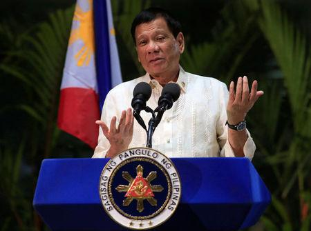 Philippine President Rodrigo Duterte gestures while answering questions during a news conference upon arrival from a trip to Myanmar and Thailand at an international airport in Manila, Philippines March 23, 2017. REUTERS/Romeo Ranoco
