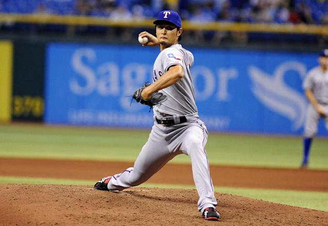 Texas Rangers starting pitcher Yu Darvish, of Japan, delivers to the Tampa Bay Rays during the fifth inning of a baseball game Thursday, Sept. 19, 2013, in St. Petersburg, Fla. (AP Photo/Brian Blanco)