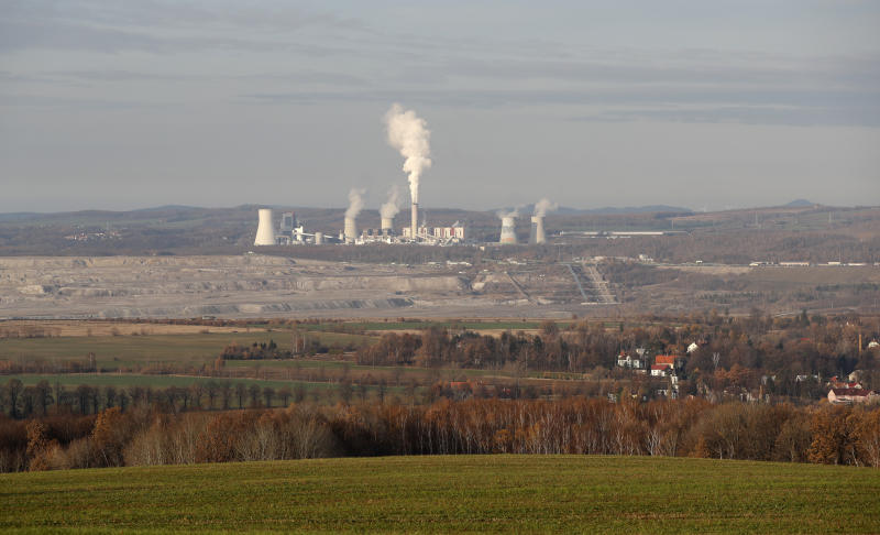 The Turow lignite coal mine and Turow power plant near the town of Bogatynia, Poland, Tuesday, Nov. 19, 2019. The Turow lignite coal mine in Poland has an impact on the environment and communities near the border of three neighboring countries, the Czech Republic, Germany and Poland. Plans to further expand the huge open pit mine have caused alarm among residents who fear things might get even worse. (AP Photo/Petr David Josek)