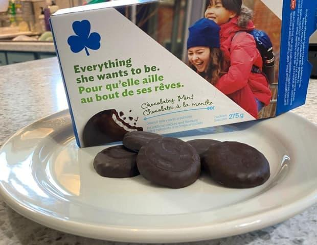 Girl Guides across Newfoundland and Labrador have a surplus of 1,500 boxes of mint cookies they need to sell by the end of August. (John Gushue/CBC - image credit)