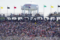 Fans fill the stands during the Indianapolis 500 auto race at Indianapolis Motor Speedway in Indianapolis, Sunday, May 30, 2021. About 135,000 spectators are admitted to the track, for the largest sports event since the start of the pandemic. It's about 40% of attendance and leaves 100,000 empty seats in the permanent grandstands. (AP Photo/Paul Sancya)