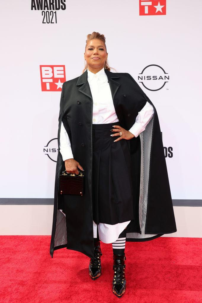 Queen Latifah attends the BET Awards 2021 in a shirt dress, cape, and matching boots