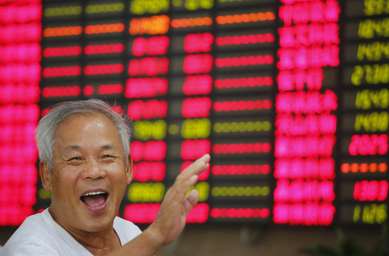 An investor gestures in front of a stock price monitor at a private securities company Friday Aug. 23, 2013 in Shanghai, China. Asian stock markets rose Friday after encouraging economic data from China and Europe raised hopes that a global economic recovery was underway. (AP Photo)