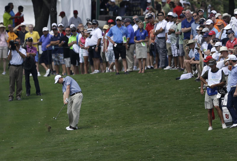 Tom Gillis hits from the first fairway during the third round of the Byron Nelson Championship golf tournament Saturday, May 18, 2013, in Irving, Texas. (AP Photo/Tony Gutierrez)