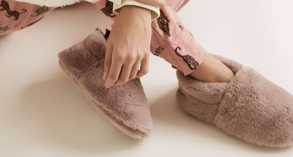 M&S' Faux Fur Slipper Boots are sure to keep your feet cosy this autumn. (M&S)