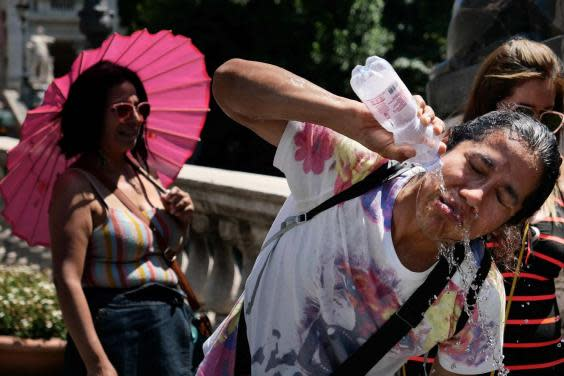 Tourists in Rome struggle in the heat, 24 June 2019 (AFP/Getty Images)