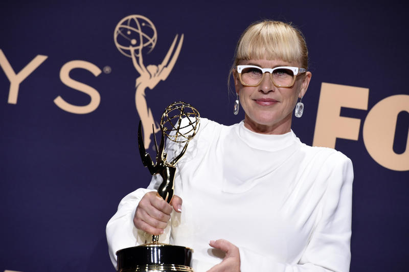"Patricia Arquette poses in the press room with the award for outstanding supporting actress in a limited series or movie for ""The Act"" at the 71st Primetime Emmy Awards on Sunday, Sept. 22, 2019, at the Microsoft Theater in Los Angeles. (Photo by Jordan Strauss/Invision/AP)"