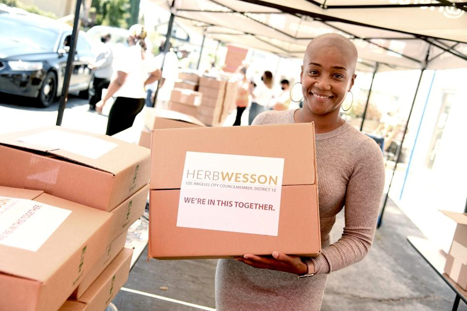 <p>Tiffany Haddish helps donate Chromebook computers to students in foster care during a drive-through giveaway event at city councilmember Herb Wessons's district office in L.A. on Thursday. </p>