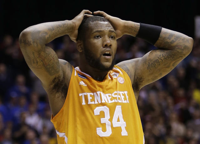 Tennessee's Jeronne Maymon reacts during the second half of an NCAA Midwest Regional semifinal college basketball tournament game against the Michigan Friday, March 28, 2014, in Indianapolis. (AP Photo/David J. Phillip)