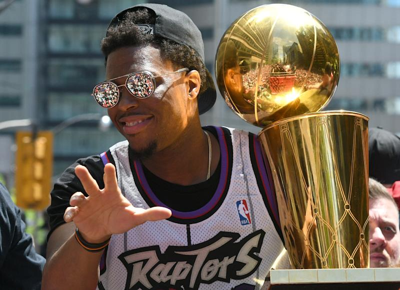 Jun 17, 2019; Toronto, Ontario, Canada; Toronto Raptors guard Kyle Lowry shows off the Larry O'Brien trophy to fans during a parade through downtown Toronto to celebrate their NBA title. Mandatory Credit: Dan Hamilton-USA TODAY Sports