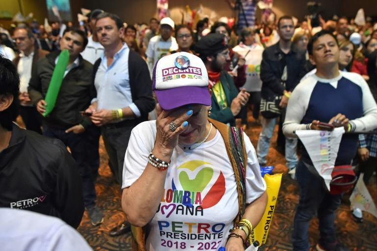 Supporters of presidential candidate Gustavo Petro react after partial results show he lost to Duque