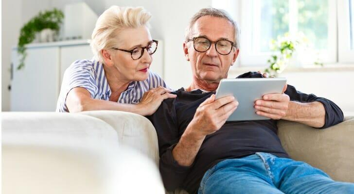 Senior couple uses an online trading platform