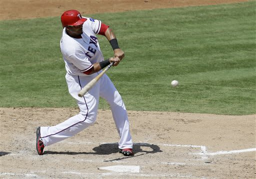 Texas Rangers' Nelson Cruz connects for a RBI-single to center off a pitch from Houston Astros' Erik Bedard in the fifth inning of a baseball game Sunday, July 7, 2013, in Arlington, Texas. The hit drove in Ian Kinsler. (AP Photo/Tony Gutierrez)