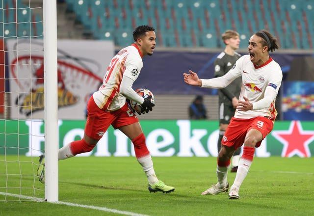 RB Leipzig's Justin Kluivert celebrates scoring his side's third goal against Manchester United