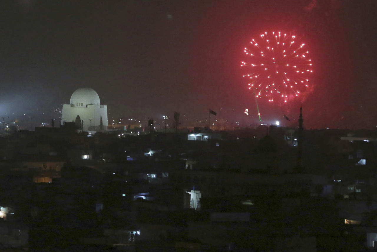 Fireworks light the sky near the mausoleum of Mohammad Ali Jinnah, founder of Pakistan to celebrate the Independence Day in Karachi, Pakistan, Tuesday, Aug. 14, 2018. Millions of Pakistanis celebrate the 71st Independence Day from British rule. (AP Photo/Shakil Adil)
