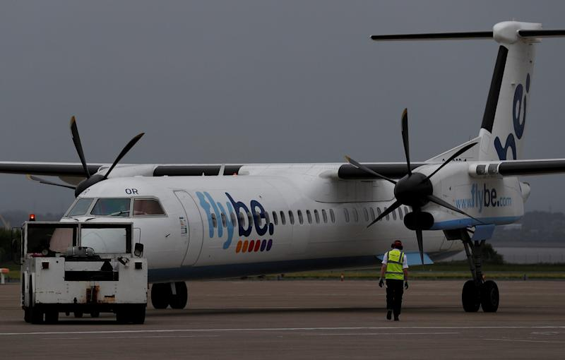 FILE PHOTO: An airport worker examines a flybe aircraft before it takes off from Liverpool John Lennon Airport in Liverpool northern England, May 19 , 2016. REUTERS/Phil Noble