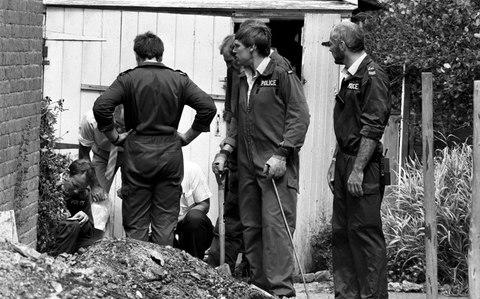Police in Hungerford searching the garden of the burnt out house of Dorothy Ryan, the 60 year old mother of Michael Ryan - Credit: PA