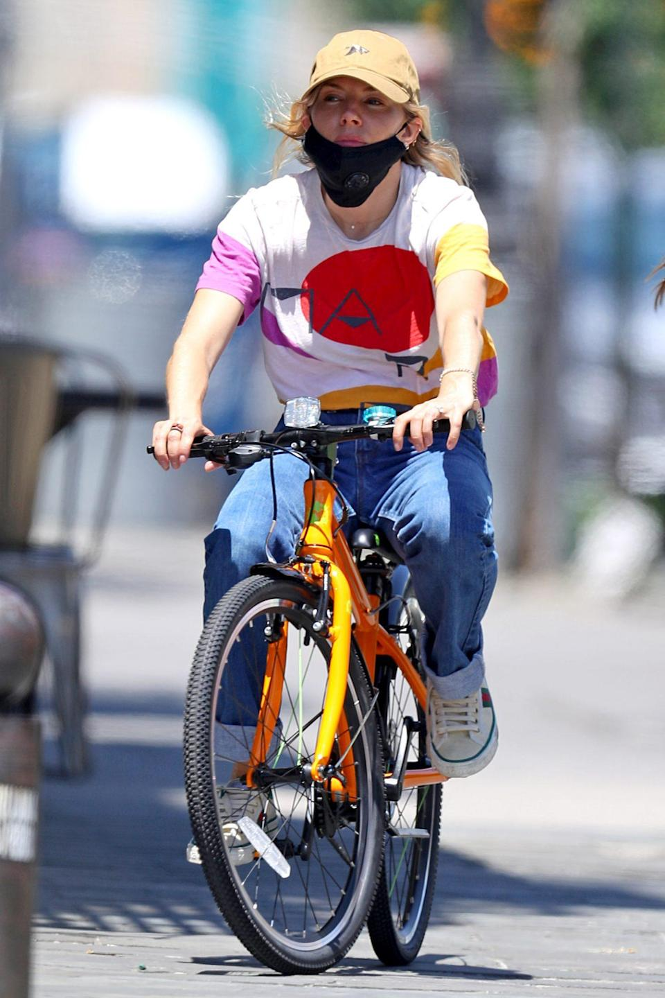 <p>Sienna Miller keeps a low profile while out for a bike ride on Tuesday in New York City. </p>