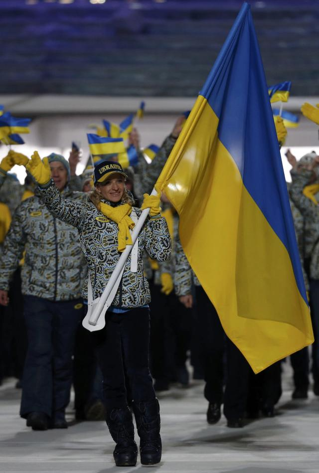 Ukraine's flag-bearer Valentina Shevchenko leads her country's contingent during the opening ceremony of the 2014 Sochi Winter Olympics, February 7, 2014. REUTERS/Phil Noble (RUSSIA - Tags: OLYMPICS SPORT)